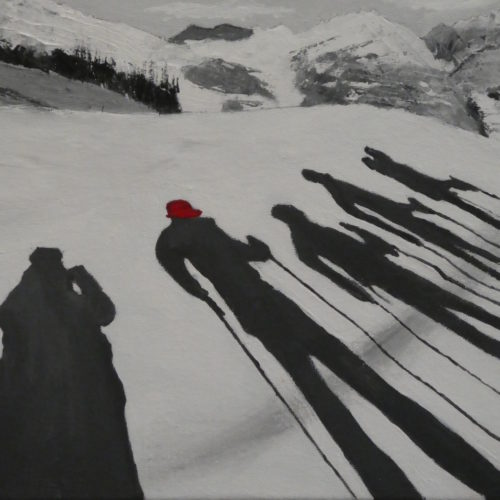 Ombres de randonneurs sur la neige