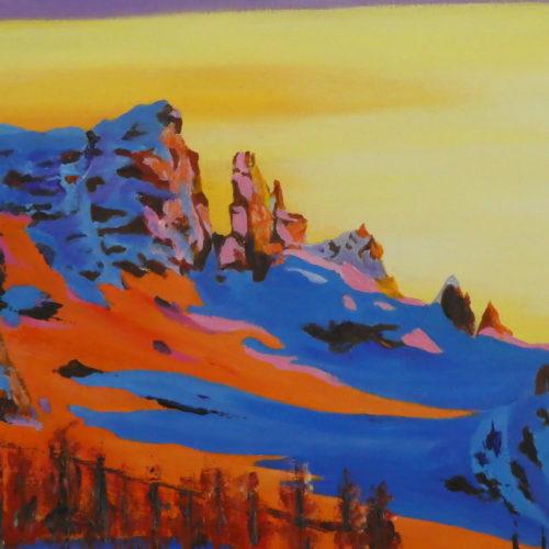 Reflet du soleil couchant sur la montagne